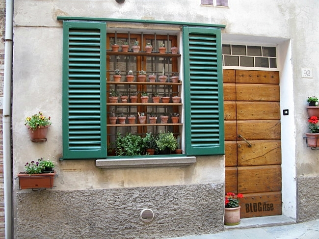 a window in Lucignano, Italy by BLOGitse