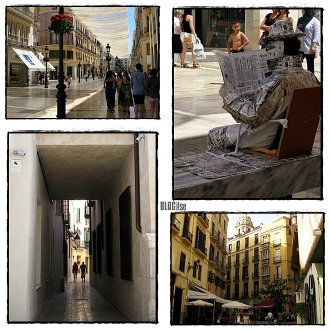 shopping or reading a newspaper in Calle Larios Malaga by BLOGitse