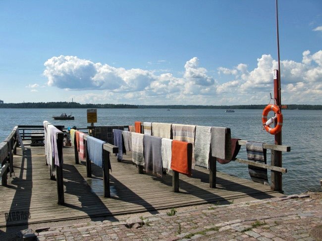 vanishing folklore washing carpets at the beach in Helsinki Finland by BLOGitse