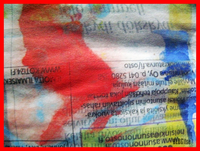 red splotch on a newspaper by BLOGitse